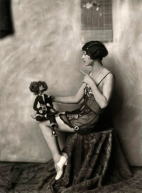 Flapper and her doll, circa the 1920's,