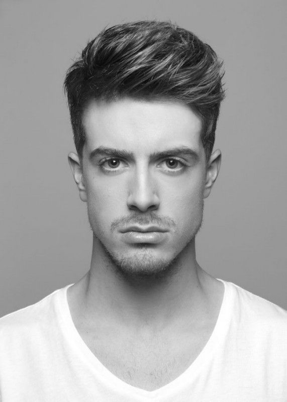 """Men's cut where the scissor over comb technique is combined with the freehand technique. Result will be 1"""" long or shorter at the top of the design panel."""