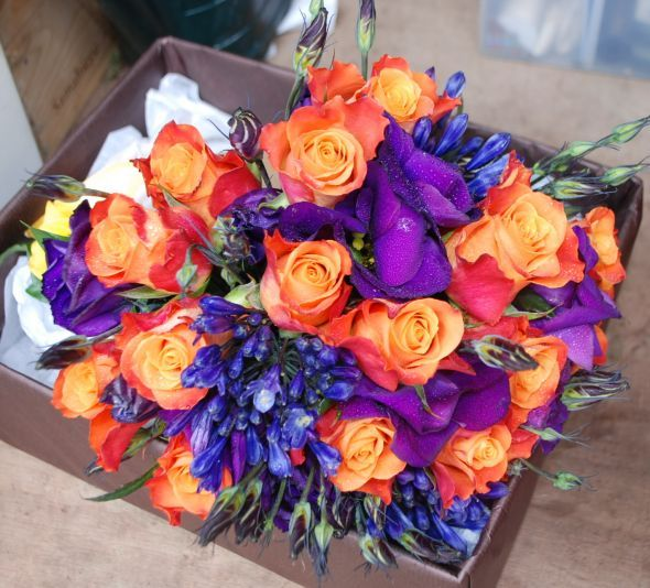 I love this bright bouquet with purple and coral