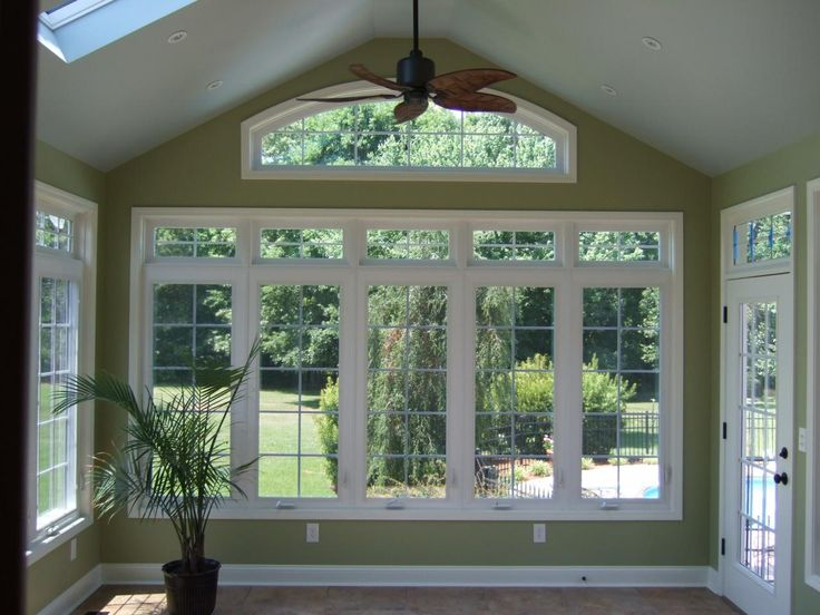Sun rooms peak builders inc additions sunrooms for Dining room window designs