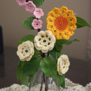 Crochet flowers - these were made using Countrywide poppets. Perfect for decorating a hat or cardigan.