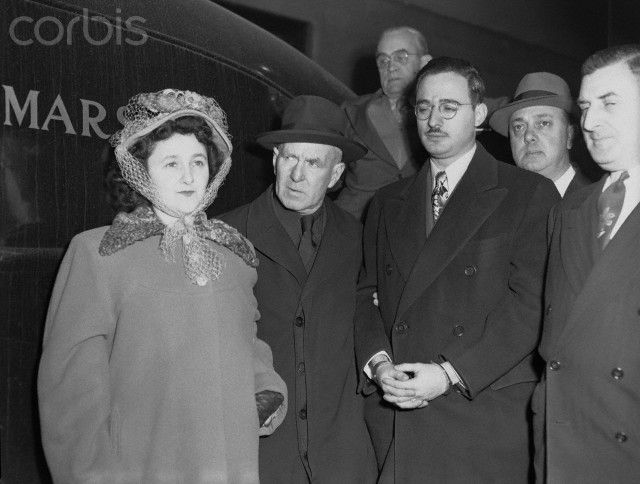 Julius Rosenberg and his wife, Ethel, are escorted into U.S. Court in New York by Deputy Marshal Harry McCabe (Center) for the opening of their trial today as key figures in the Klaus Fuchs - Harry...
