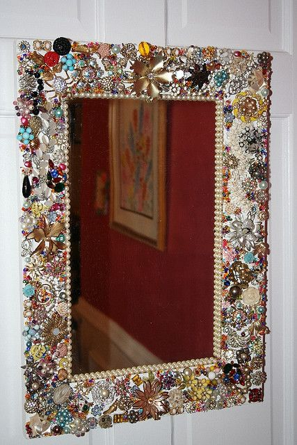 Mirrors with vintage jewelry... would be great for all grandmothers broken jewelry that I could never part with...