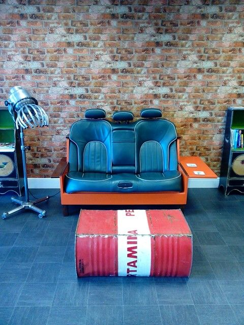 Therapy Hair Salon interior. Car seat Sofa and vintage Wella hood dryer converted into a light.