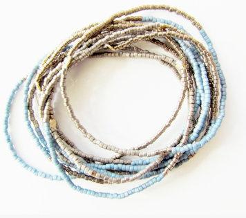 Glass beaded stretch bracelets: Set of 10 glass beaded stretch bracelets with 14k gold filled closures.  $80