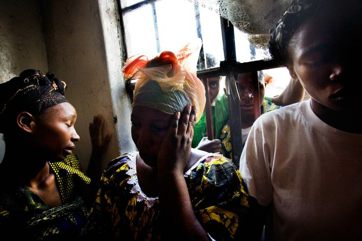 Family members mourn the loss of two women killed during the violence and widespread looting by government forces in Goma in October 2008. PHOTOGRAPH BY DOMINIC NAHR, MAGNUM PHOTOS