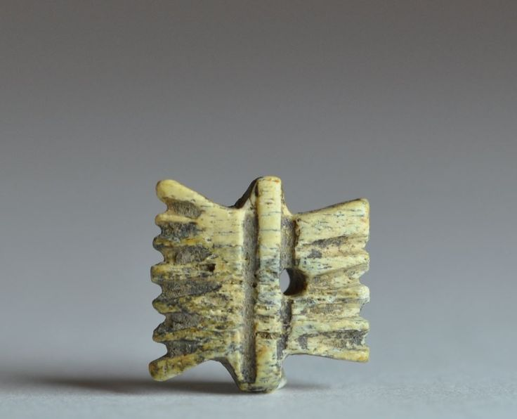 Coptic art, Coptic comb amulet, Coptic, 5th-7th century A.D. Coptic art, Coptic bone amulet in the form of a carding comb, centrally pierced for suspension, 1.3 cm high. Private collection