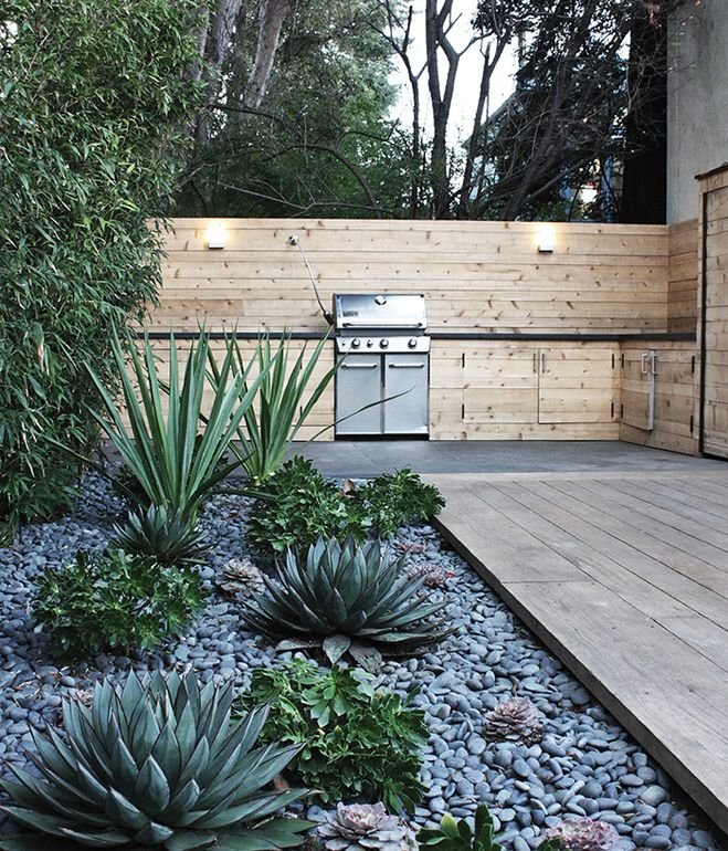 Another water-saving project in Menlo Park includes a rock bed with succulents.  Courtesy of: Ike Edeani