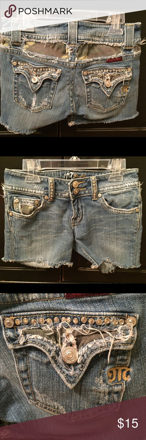 Miss Me Jean Shorts Miss Me cut off Jean shorts. Camo designs on the back & front pocket. Jeweled pockets. In good condition. Miss Me Shorts Jean Shorts