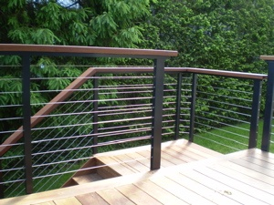 Cable deck railing & nice deck edging. /// what if we did fencing like this, through post wire instead of nailed to post?.?