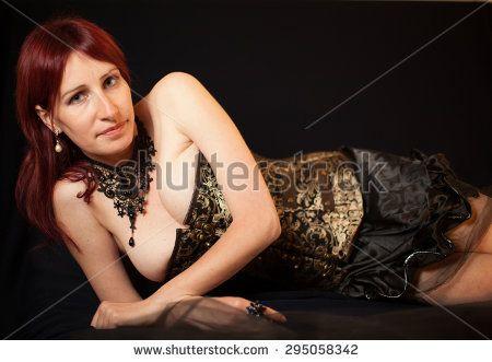 Boudoir studio portrait of gothic woman isolated on black background. #Gothic #Fashion #SteamPunk #Corset #Bust #Boudoir