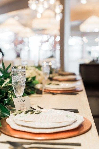 The tablescape that Posey Lane Weddings put together is beautiful. The rose gold chargers topped with ornate plates make this setting so elegant and pretty. A detail that we always love is place cards wrote in beautiful calligraphy and these place cards by Debbie Wong Design are perfect.