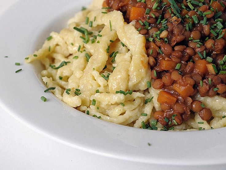 Linsen mit Spätzle (Lentils with Spaetzle [egg noodles]). You can make it vegetarian by omitting the speck. We usually use oregano, parsley and basil as the herbs.