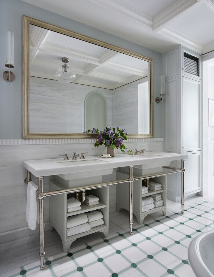 In the master bath, the texture of a fluted-marble detail creates contrast against seamless wall niches and inlaid-tile flooring highlighted by semiprecious stone | archdigest.com