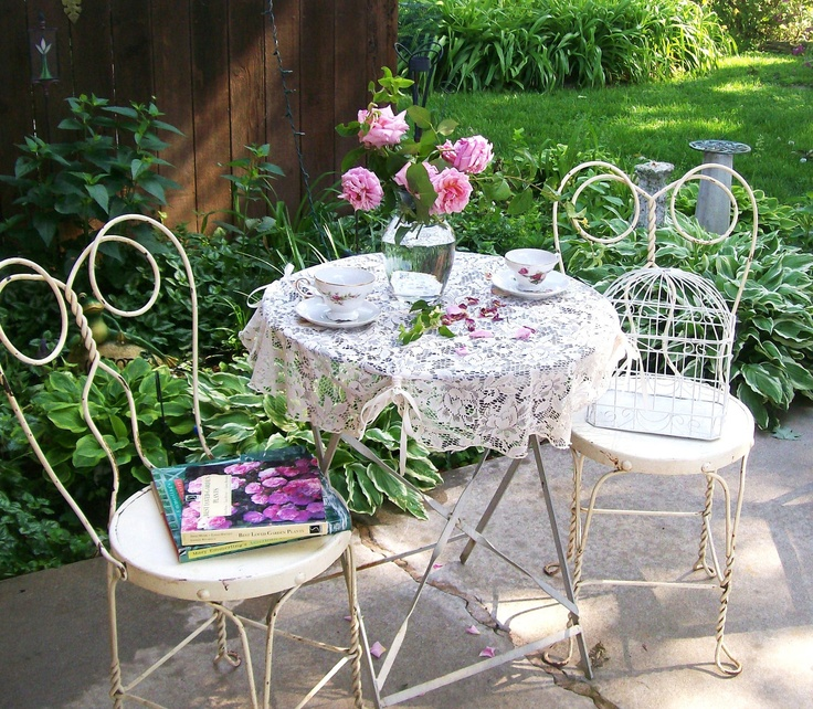I need this on my patio immediately!!!  VIntage white Shabby Chic Bistro Cafe Set. Wrought Iron Patio Set.  Antique Ice Cream Chairs. Lucite Folding PAtio TAble. $325.00, via Etsy.