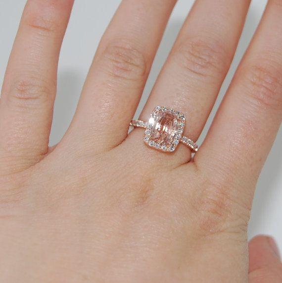 peach sapphire center with diamond accents in rose gold setting. The most beautiful thing I've ever seen!!! (probably would want a little bit of a smaller ct, like 1-1.5 or something) but the same size band. omg breath taking! sigh-one can dream lol