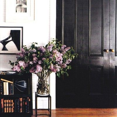 The Pursuit Aesthetic-Glossy black doors and Lilacs..two of my favorite things