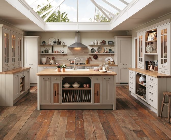 This kitchen island not only complements the shaker look but also provides some great storage solutions. This is the Tewkesbury Framed Kitchen Range by Howdens Joinery.