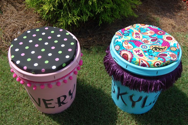 CLassroom!   Great for storing kids stuff or using it to sit on:)    (5 gallon paint bucket, fabric, foam, cardboard, spray primer, spray paint, decorative strand, scissors, sharpie and hot glue).  Top is a circle cut from a square foam cushion, then covered with fabric.