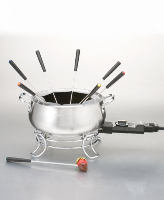 Do you fondue? Dip into the delicious craze with this new set that combines classic style with modern function. Perfect for everything from appetizers to desserts, this fondue pot features an electric temperature control that adjusts to prepare cheese, broth, oil or chocolate fondues. Sleek stainless steel construction suits every kitchen decor. Includes eight color-coded dipping forks. Model CFO-3SS.
