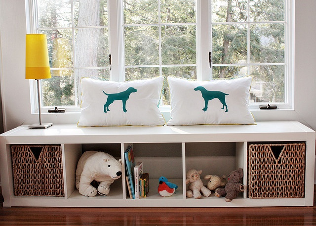 cute pillows and like the ikea shelf under the window