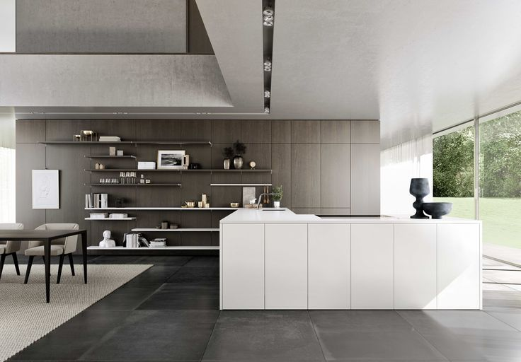 SieMatic PURE / SE 8008 LM + SE 4004 H: Creating fluid transitions: Still a wall, or a cabinet instead? – The wall panels of the SieMatic FloatingSpaces System can also be used as kitchen cabinet doors, creating an elegant visual connection: from living and eating area to the fully equipped, highly functional cooking area.