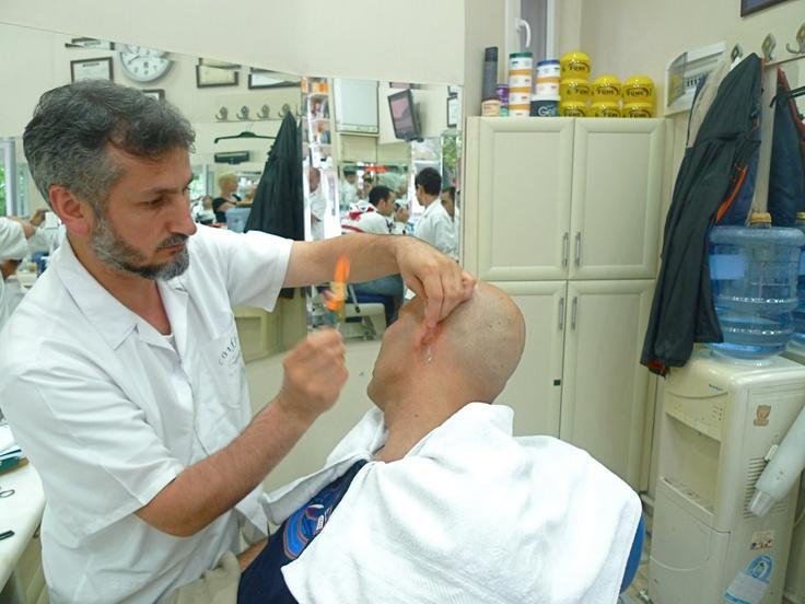 Singeing the ear hair ~ Cihangir, Istanbul, May 2011 holiday #travel #barber #barbershop