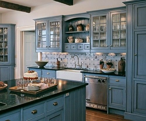 "Dutch blue. Occasionally, one element drives the color scheme. ""The owner chose the color to match the delft tiles,"" says James Crisp of Crisp Architects. ""It's actually a faux finish with an overcoat of a black texture."""