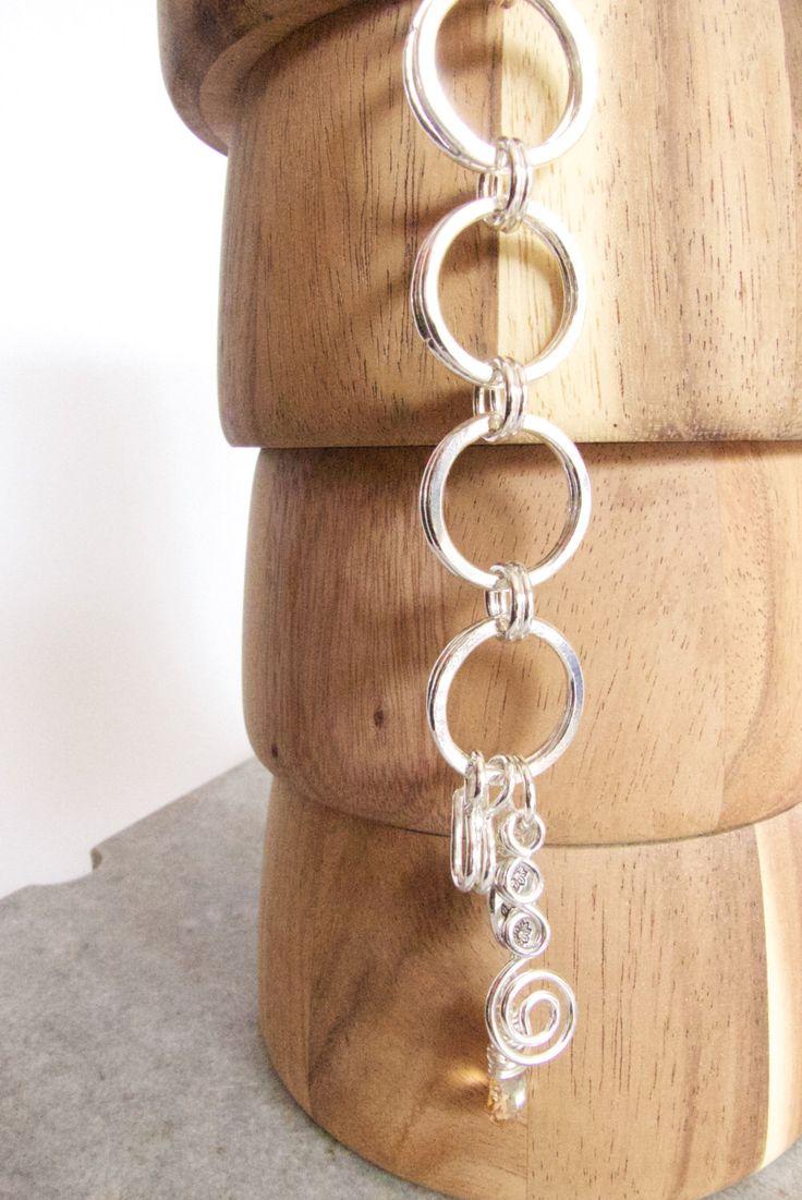 A personal favourite from my Etsy shop https://www.etsy.com/au/listing/254196859/silver-circle-bracelet-golden-swarovski