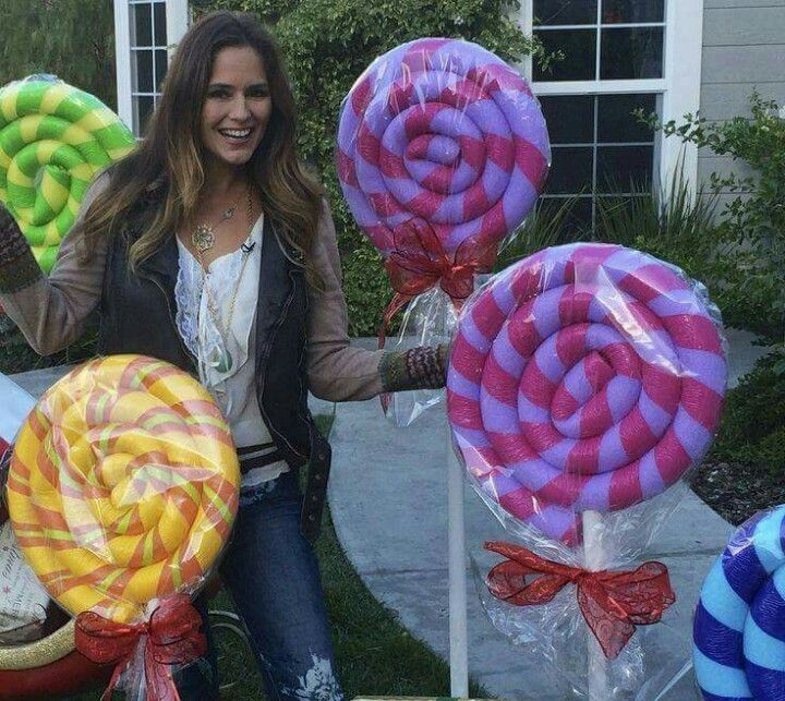 Make gigantic lollypops with pool noodles. Great idea!