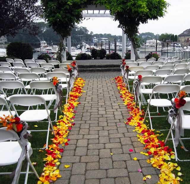 Outdoor Wedding Aisle in Yellow and Red Rose Petals by Flower Factor, via Flickr