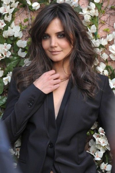 Katie Holmes for Ann Taylor... LOVE the neutral brown color...the hints of dark espresso slices create this amazing dimension in her hair; and the lose waves fall perfectly accentuating her eyes and cheek bones.