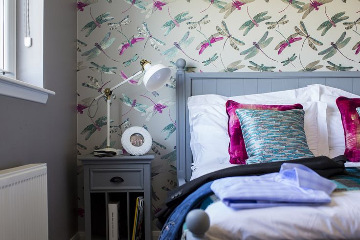 Gorgeous bedroom at Walker Group's Ashton Gardens in Kirkliston with eye-catching dragonfly wallpaper
