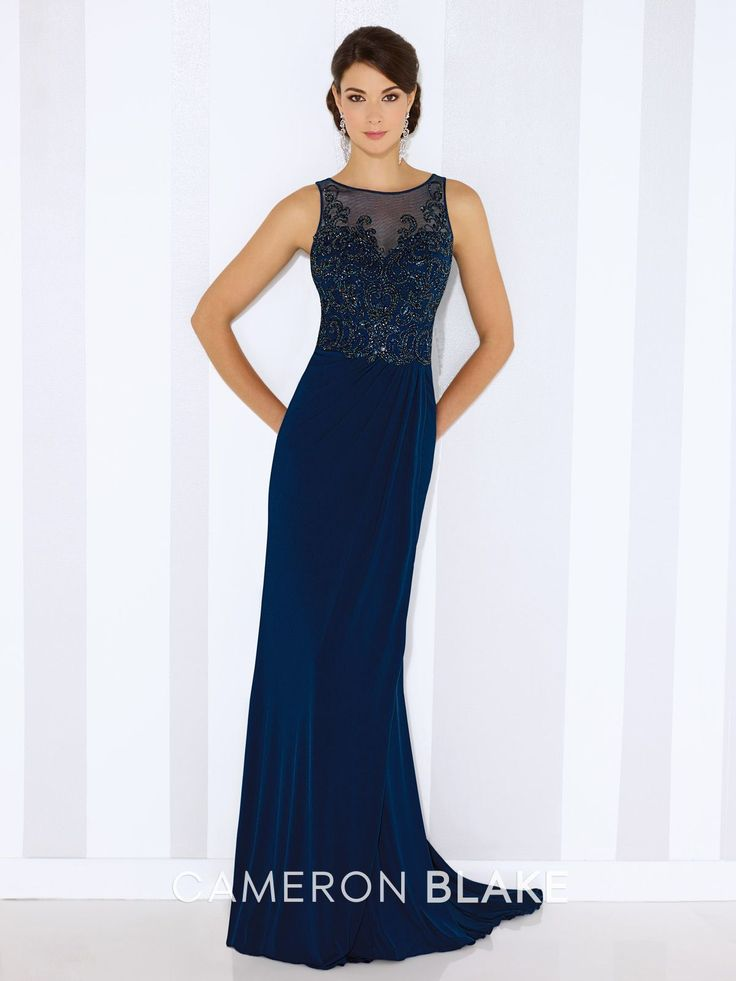 Sleeveless jersey sheath, illusion jewel neckline over hand-beaded sweetheart bodice, beaded illusion back, side gathered skirt with sweep train. Matching shawl included Sizes: 4 – 20 Colors:Blue Willow, Eggplant, Mink
