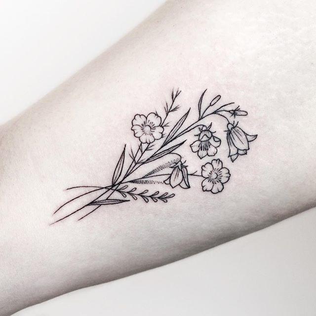 Small Flower Tattoo Idea
