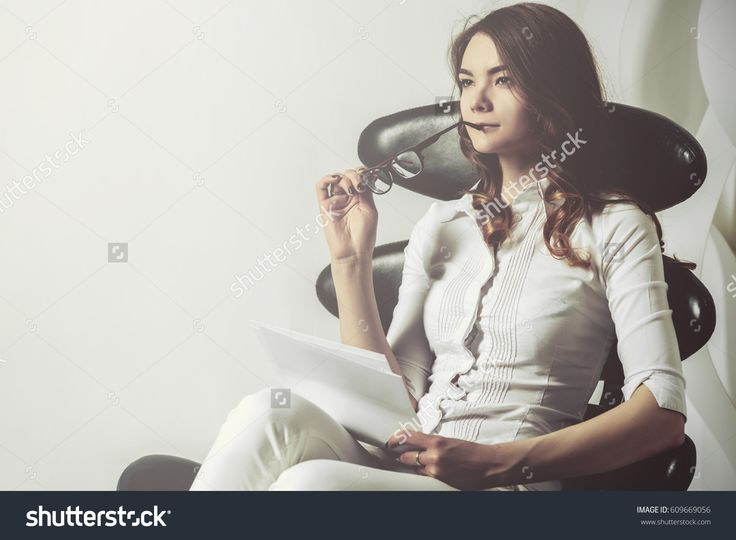 A determined girl sits on a chair