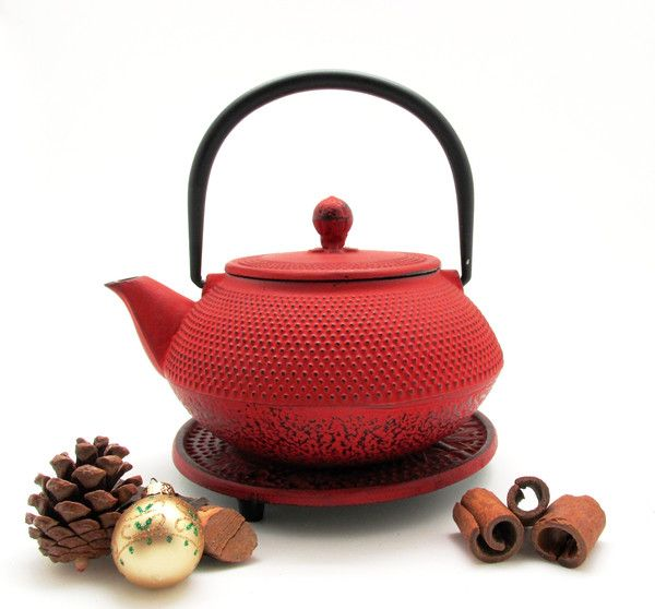 Tokyo Cast Iron Tea Pot and Trivet is the perfect tea pot to brew in an authentic Japanese teapot. Enjoy a warm cup of tea in style. Includes a basket infuser
