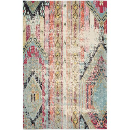 Anchor a bohemian seating group or lend a pop of free-spirited flair to your master suite with this loomed rug, featuring a multicolored geometric pattern.