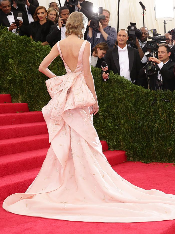 Taylor Swift in a gorgeous light pink backless gown