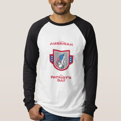Patriots Day Greeting Card American Patriot Holdin T Shirt. Patriots Day greeting card featuring an illustration of an American Patriot brandishing holding up USA stars and stripes flag set inside crest shield on isolated white background with the words Proud to be American and Happy Patriots Day. #illustration #PatriotsDayGreetingCardAmericanPatriotHoldin