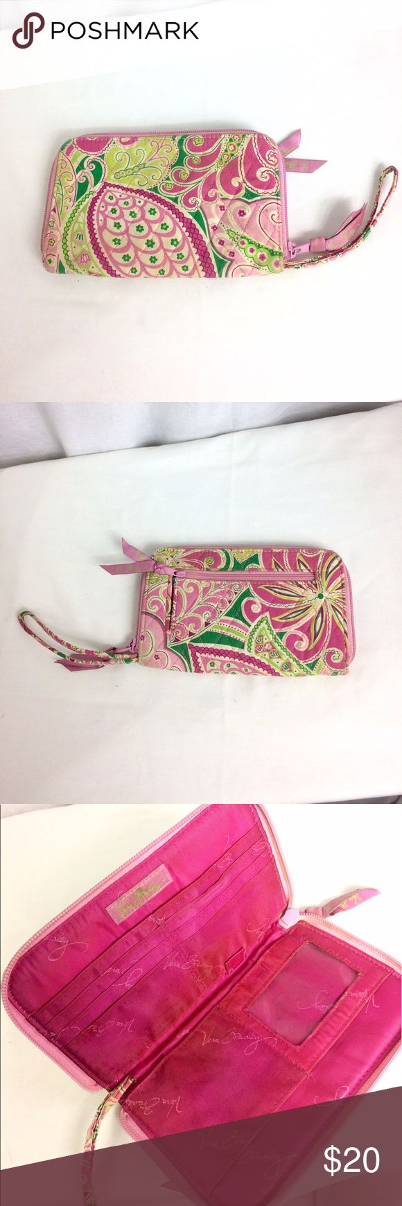 "Vera Bradley Wristlet in Pinwheel Pink This Wristlet has been preloved, but is still in good condition. The outside is in pretty good shape, but there is some slight discoloration on the inside. Also, it has become quite flexible with use, & the cardboard inside is no longer very stiff. The Pinwheel Pink pattern ran Jan. 2008 - May 2009. The dimensions measure about 8"" x 5"" x .75"" with a 11"" wrist strap. Reasonable official offers may be considered 😊 Vera Bradley Bags Clutches & Wristlets"