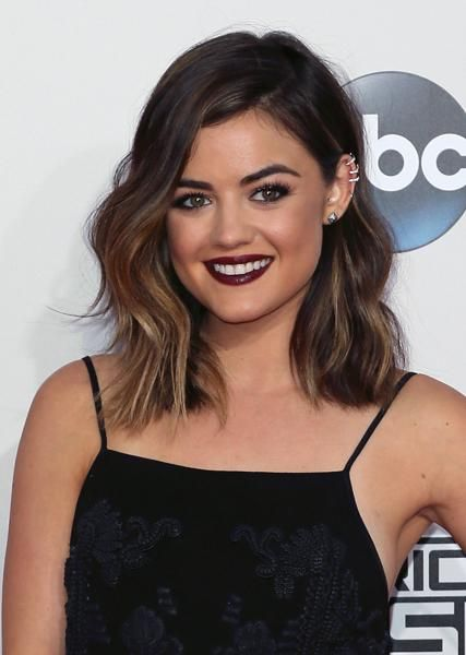 Lucy Hale's lob is a perfect fit for her face shape and hits right between her collarbone and shoulders. We love how Kristin Ess styled it with waves that don't try too hard; they keep her looking youthful without overly young—a spot-on style for a 20-something. | www.claritybeauty.com