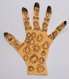 Henna hand print. You can let your child pratice drawing henna with markers and not all over their hands. Quick and easy project.