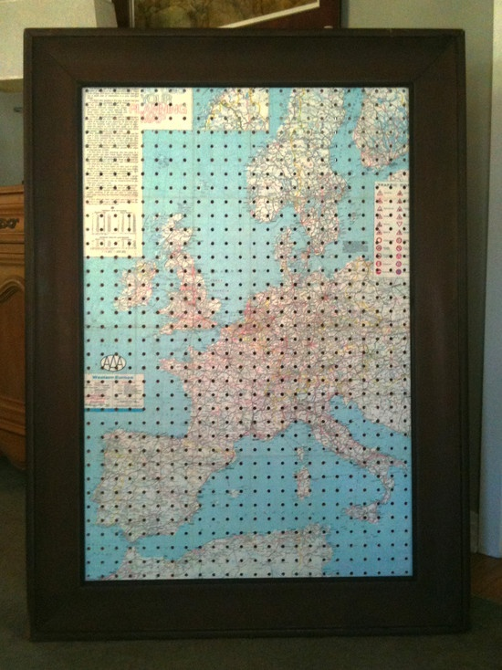 Pegboard. Decoupage map onto pegboard, while still a little wet, poke through map.