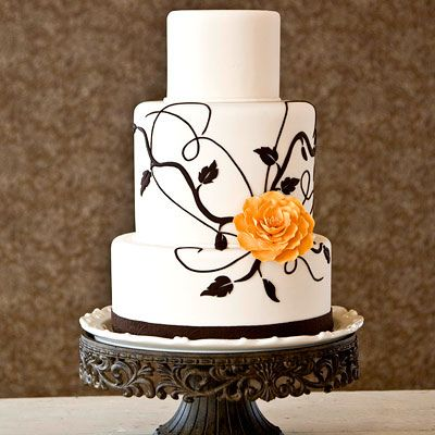 Black and white wedding cake.    I love the simplicity of this cake but I would make the flower red