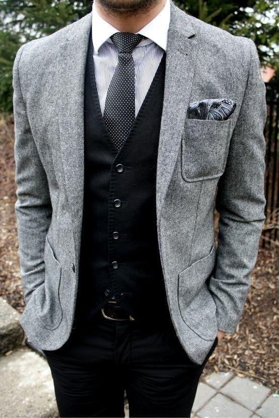 Grey Wool Blazer  — Black Waistcoat  — Black and White Polka Dot Tie  — White Vertical Striped Dress Shirt  — Grey Paisley Pocket Square  — Black Leather Belt  — Black Dress Pants