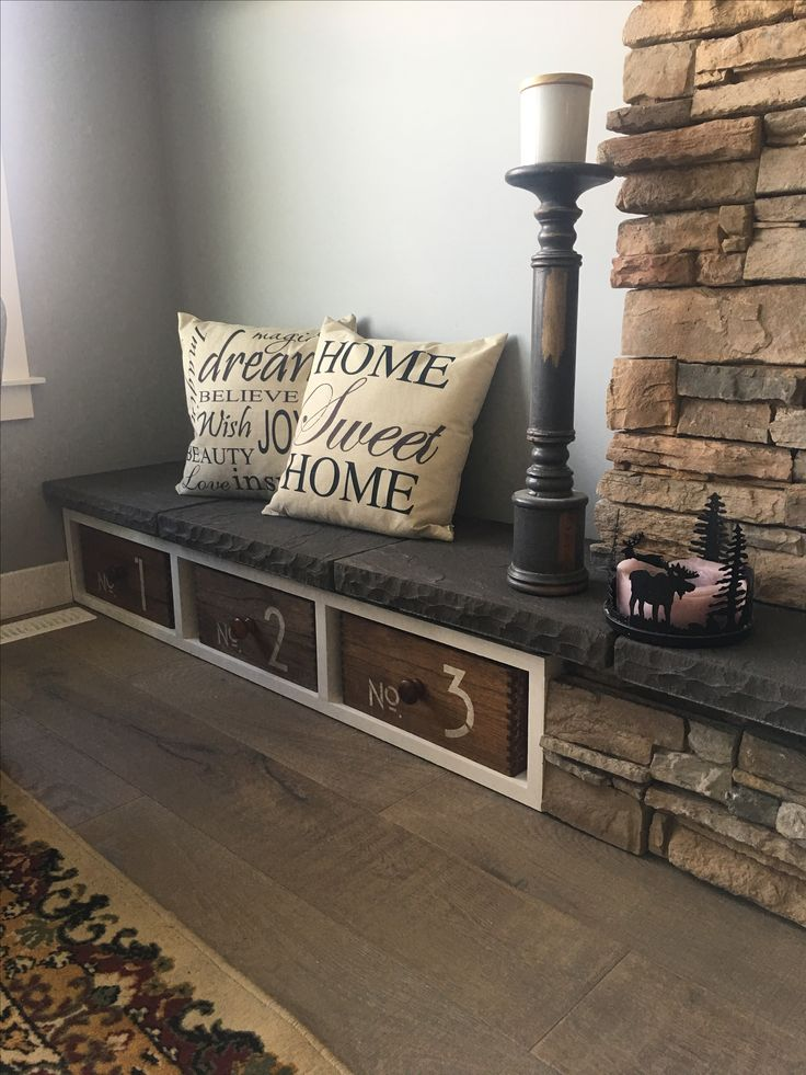 Fireplace hearth seating with stencilled repurposed Jysk wooden boxes