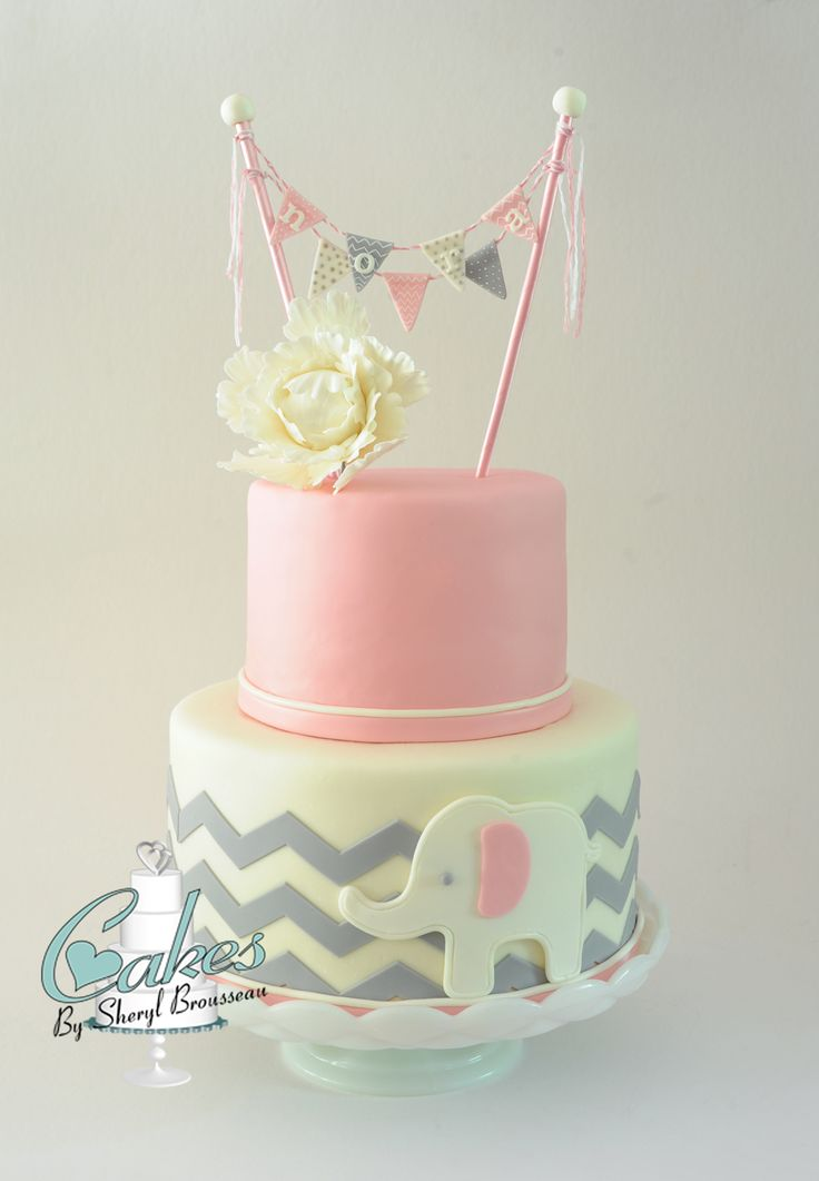 Pink, White, and Gray Chevron Baby Shower Cake - What a pleasure to sit back and watch my assistant/daughter design and make this baby shower cake for her sister-in-law with almost no help from me.  The pink and white theme, with the gray chevron pattern and the little elephant match the nursery.  Marvelous Molds chevron onlay made this job a lot easier.