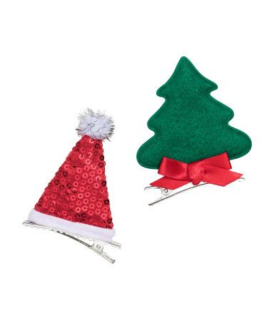 Hair clips in metal with fabric decorations. Width 2 1/4 in., height 3 1/4 in.
