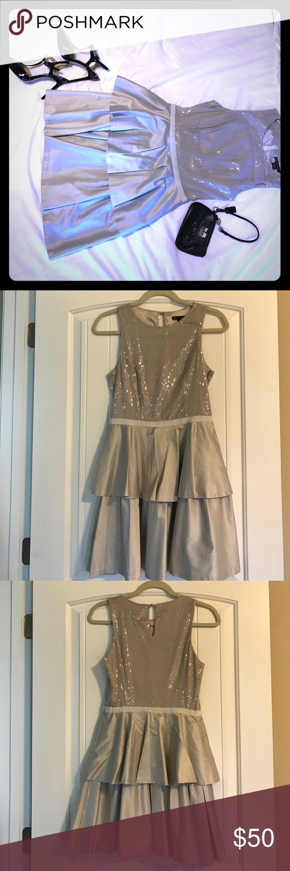 "Silver silk and sequins dress Perfect for the holidays coming up! This sleeveless silver silk and sequins dress has adorable 2 layer skirt and a sequins top for the perfect ""wow"" factor! In excellent condition! A/X Armani Exchange Dresses Mini"